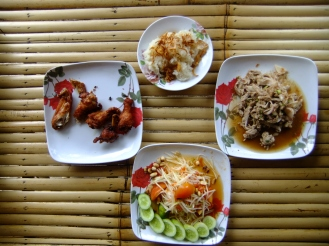Fried chicken, papaya salad and laab salad, Thailand