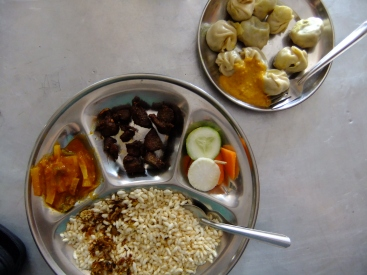 Momos (a bit like Chinese dumplings) and a thali with rice crispies instead of rice!, Nepal
