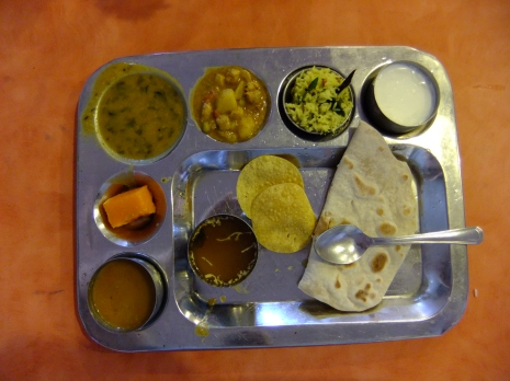 A posh thali with curries, dal, yoghurt, chapati, salad and dessert, India