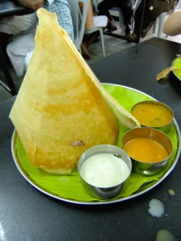 A huge paper thin dosai with coconut and dal curry, India