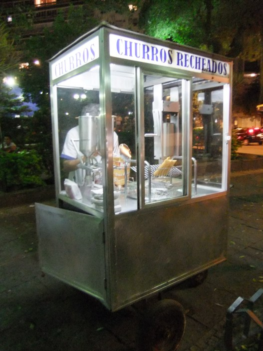 Stand selling delicious doughnuts (churros) pumped full of dulce de leche, Brazil