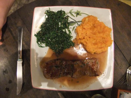An atypically good Brazilian meal: steak, mash and spinach