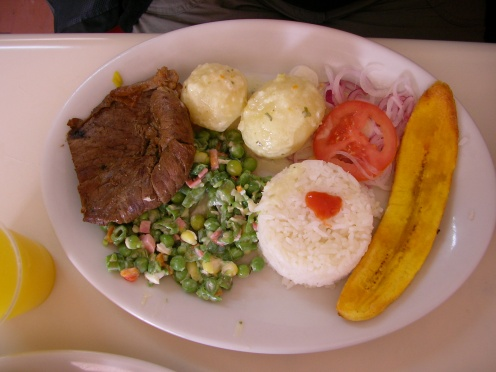 A typical set lunch (meat, lentils, potatoes, rice, salad and plantain), Colombia