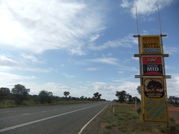 Sign for an outback roadhouse, near Alice Springs, Australia