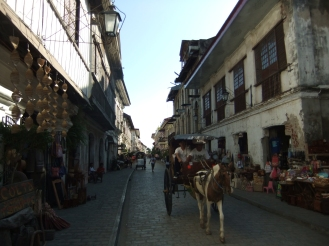 Horse and carriage on the main street in Vigan, Philippines