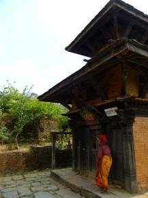 Tending to a shrine, Bandipur, Nepal