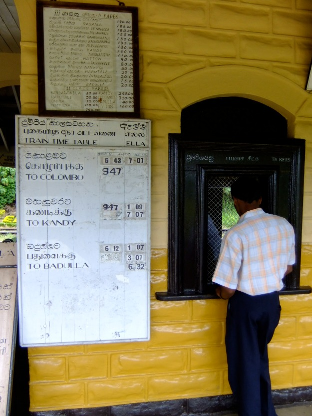 Queuing for tickets at old fashioned Ella train station, Sri Lanka