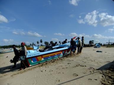 Helping the locals move a boat, Uppuveli, Sri Lanka