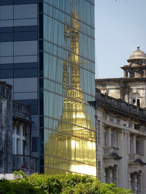 Sule Pagoda reflected in modern block
