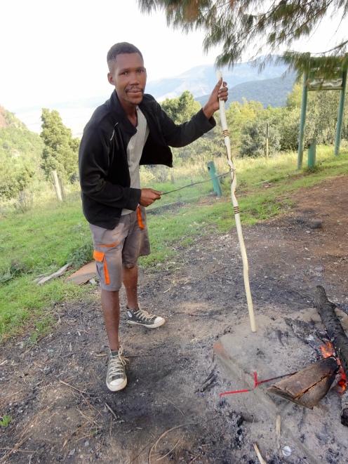 Man making carved walking sticks